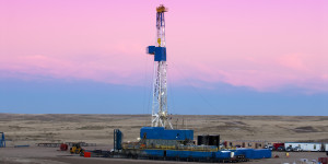 oil fracturing drilling rig at dusk