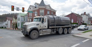 With fracking comes and increase in heavy trucks on roads designed for smaller vehicles. Over time, teh quality of roads will increase at a faster rate. Who will pay for the upkeep of municipal roads? (image source: inthesetimes.com)